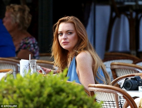 Lindsay Lohan braless in halter-neck top for lunch date in