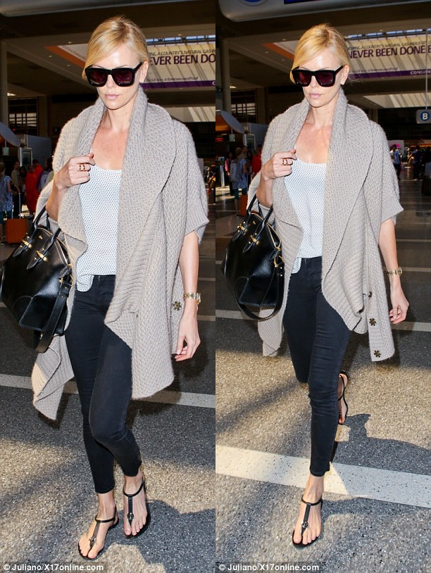 Charlize Theron Scores Major Style Points for This Plane ...