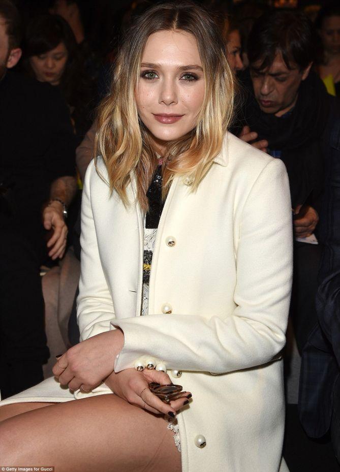 Elizabeth Olsen Showcases Legs In Sky High Platform