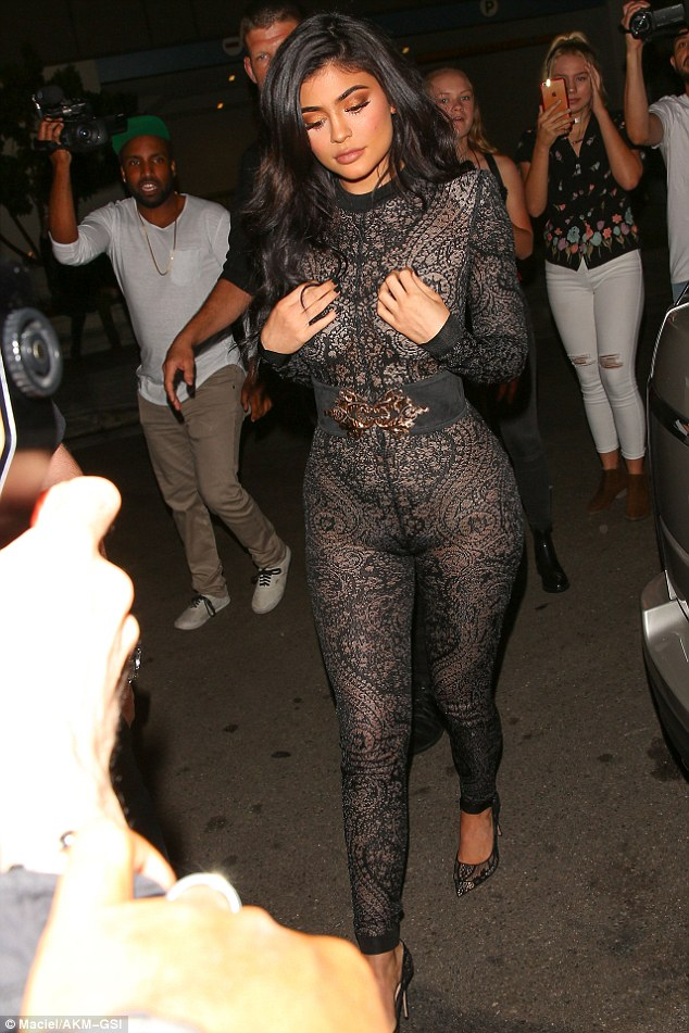 36C43FFD00000578-3717675-Jumped_the_gun_Kylie_Jenner_wore_a_see_through_lace_jumpsuit_as_-a-108_1470042497780