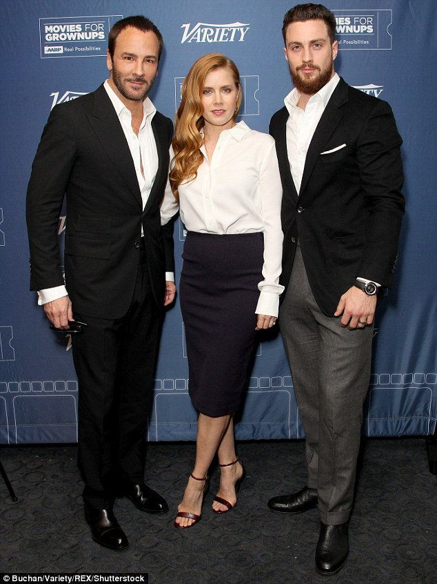 3a0d1bd000000578-3904160-the_three_amigos_she_was_joined_by_director_tom_ford_and_aaron_t-a-10_1478245600402