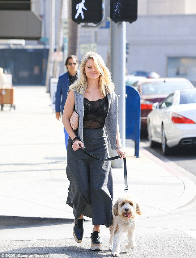 Alice Eve Walks Her Dog In Style Wearing A Pair Of Stella
