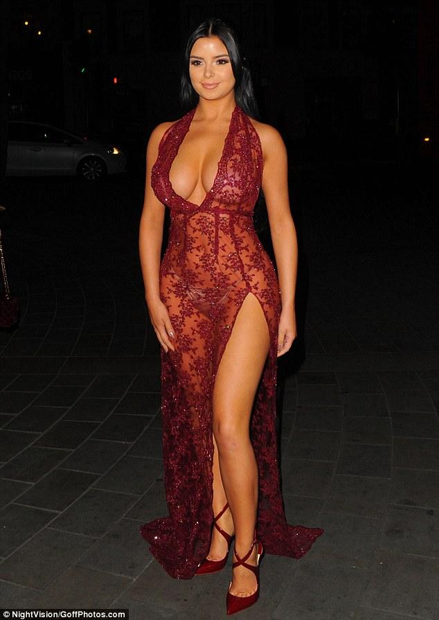Demi Rose Shows Off Her Figure In A Shear Burgundy Dress