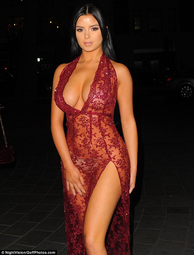 Demi Rose Shows Off Her Figure In A Shear Burgundy Dress