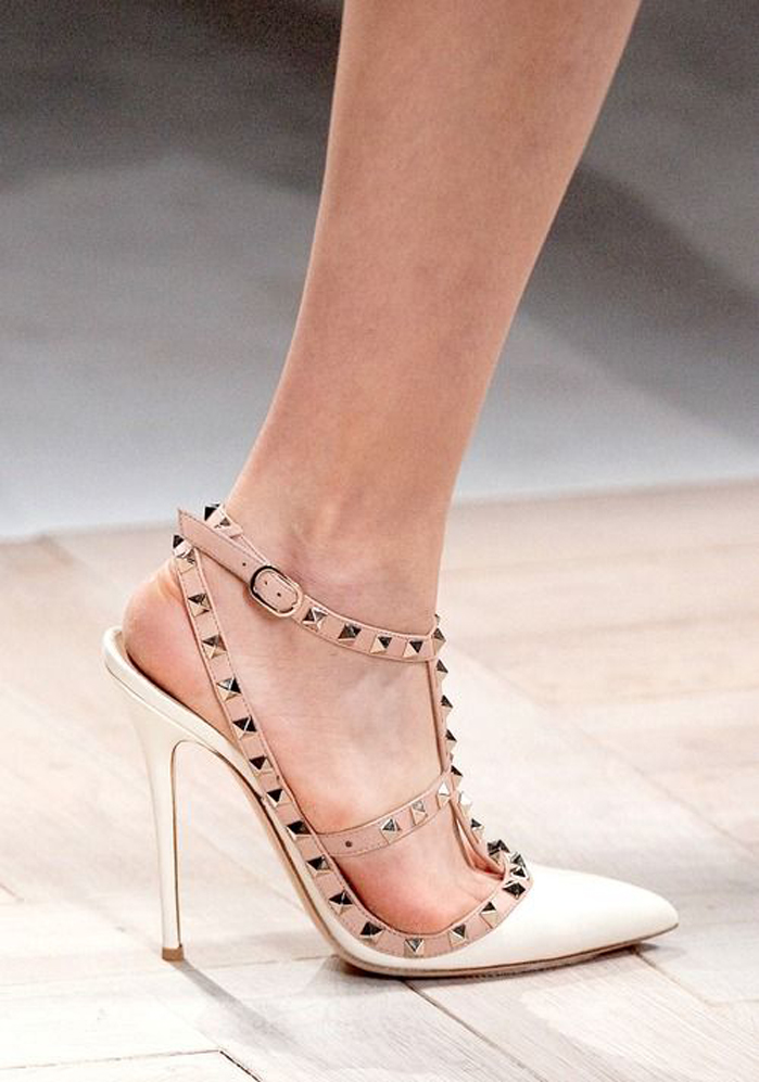 9e5e2687823 Ivory and powder pink leather Valentino Garavani  Rockstud  pumps from  Valentino featuring a pointed toe