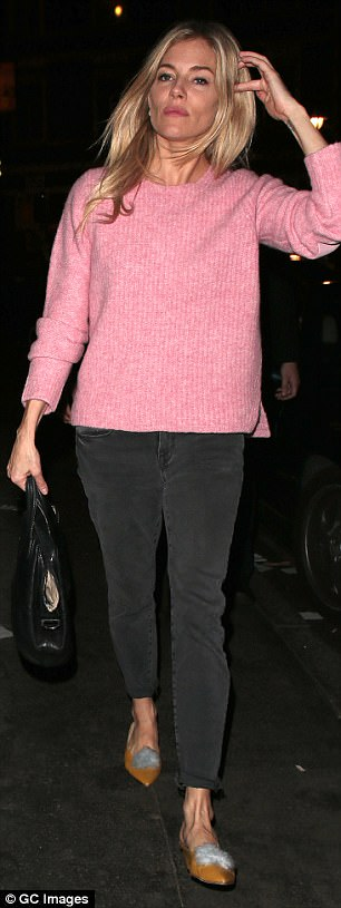 Jennifer Aniston Steps Out In Micro Mini Sweater Dress