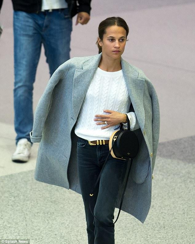 Newlywed Alicia Vikander flaunts her wedding ring in Miami